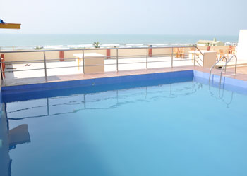 Swimming Pool and beach view from Hotel Naren Palace, Puri